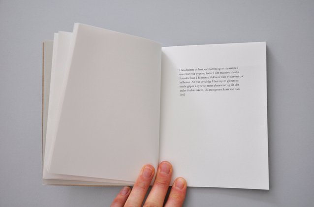Overview of handmade artists book with short peotic texts. Photography.